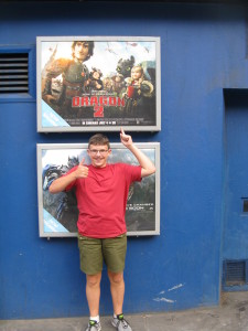 """Alex in front of the """"How to Train Your Dragon 2"""" poster. Alex said it is the best movie he has seen. I wouldn't go that far but it was an enjoyable film. Tomorrow it is off to the French Riviera!"""