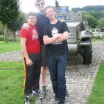 Alex, Kevin and David in front of a half track in a small Belgian village.
